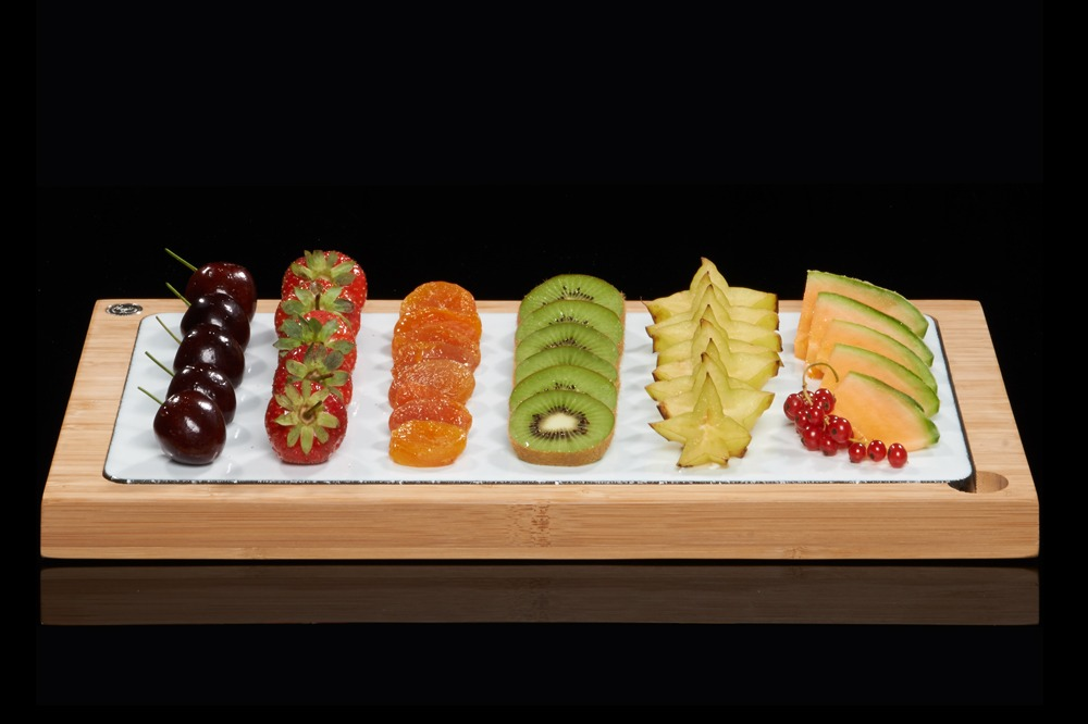 The SteakStones Glazed Lava Plate in White with Chilled Fresh Fruit Medley