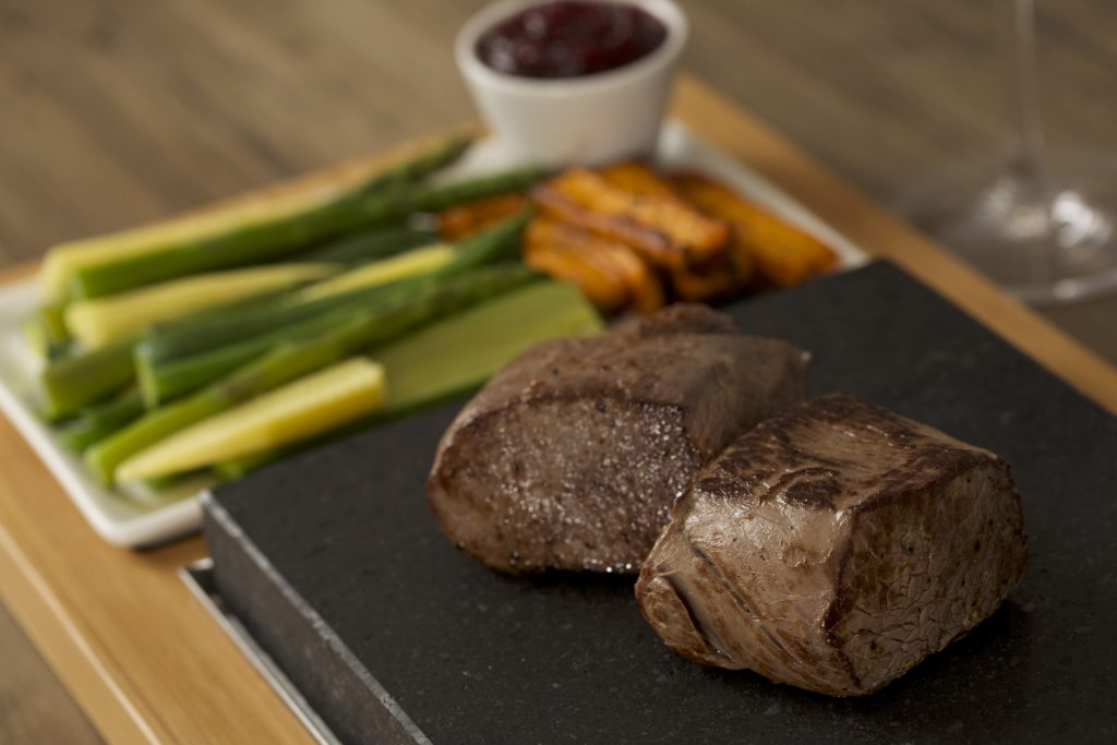 A Duo of Venison Fillets, Winter Vegetables & Redcurrant Compote on the SteakStones Steak Plate Set