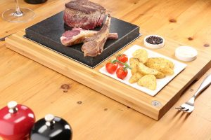 fillet-steak-lamb-cutlets-sizzling-on-the-steak-plate-sauces-set-from-steakstones-1500