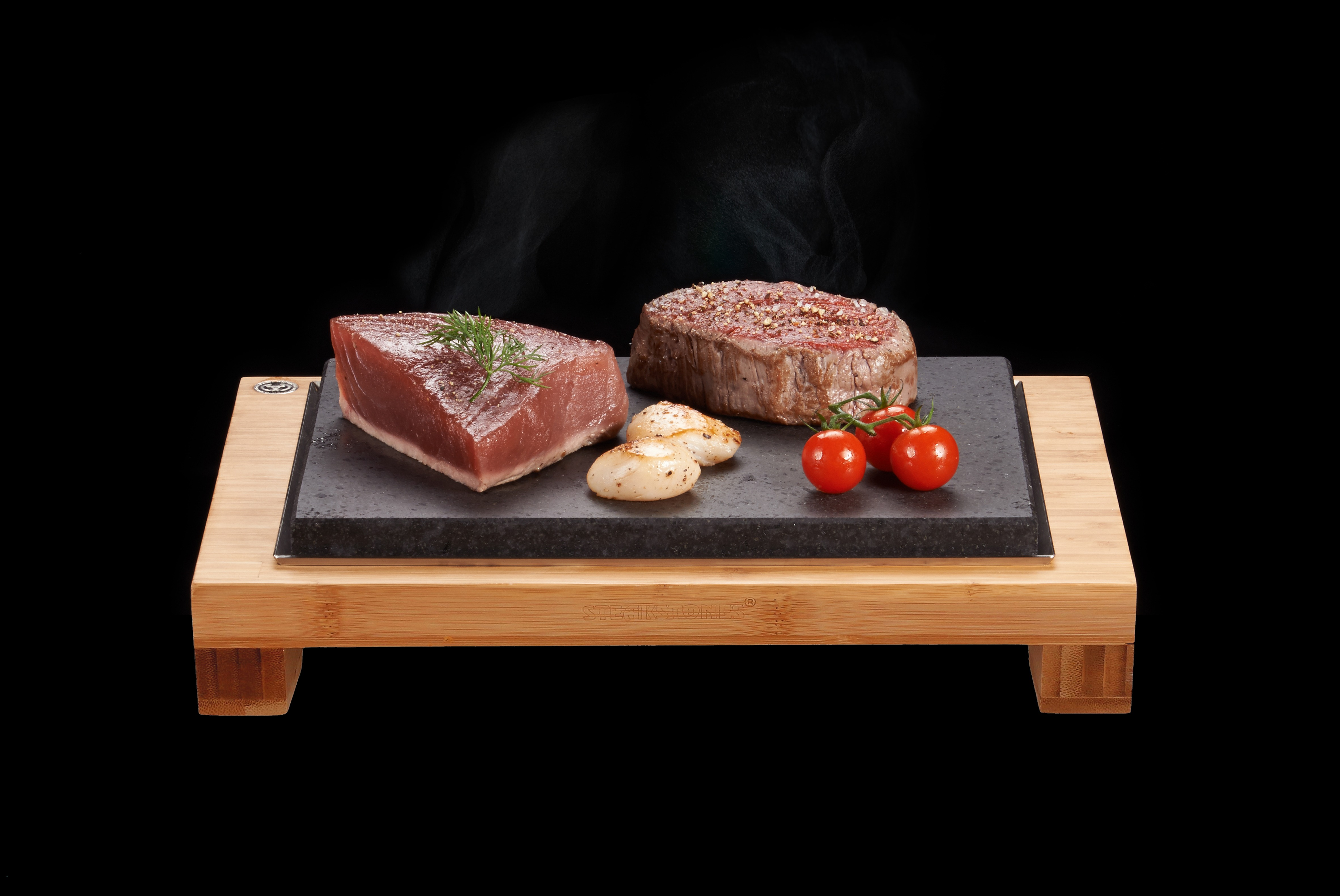 Share some delicious cuts of Steak with the Raised Sharing Steak Plate. The Perfect Meal for Two. The Raised Steak Sharer featuring Fillet Steak, Scallops and Tuna Sizzling on Steak on a Stone Lava Rocks Cooking Products. The best stone grill cooking products guaranteed.